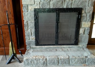 Fireplace doors with sword stand